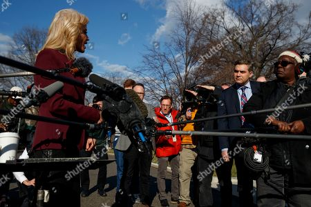White House senior adviser Kellyanne Conway talks to CNN journalist Jim Acosta during a press gaggle outside the White House, in Washington
