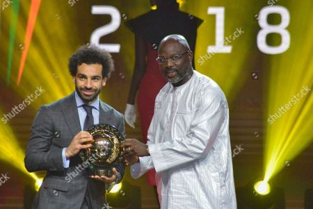 Mohamed Salah from Egypt (L) receives the Player of the Year award from Liberian president George Weah (R) during the Confederation of African Football (CAF) awards at the Abdou Diouf International Conference Center in Dakar, Senegal 08 January 2019.