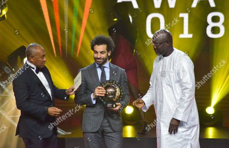 Mohamed Salah from Egypt (C) receives the Player of the Year award from Liberian president George Weah (R) and CAF president Ahmad Ahmad (L) during the Confederation of African Football (CAF) awards at the Abdou Diouf International Conference Center in Dakar, Senegal 08 January 2019.