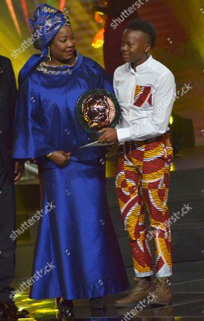 Chrestinah Thembi Kgatlana from South Africa (R) receives the Womens Player of the Year award during the Confederation of African Football (CAF) awards at the Abdou Diouf International Conference Center in Dakar, Senegal 08 January 2019. Chrestinah Thembi Kgatlana also won the best goal award.