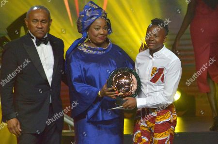 Chrestinah Thembi Kgatlana from South Africa (R) receives the Womens Player of the Year award from FIFA secretary general Fatma Samoura (C) with CAF president Ahmad Ahmad (L) during the Confederation of African Football (CAF) awards at the Abdou Diouf International Conference Center in Dakar, Senegal 08 January 2019. Chrestinah Thembi Kgatlana also won the best goal award.