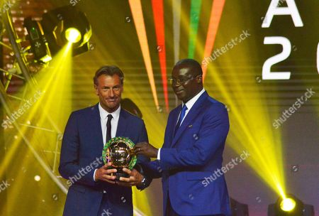 Morocco coach Herve Renard from France (L) receives the Coach of the Year award from Augustin Senghor president of Senegal Football Federation (R) during the Confederation of African Football (CAF) awards at the Abdou Diouf International Conference Center in Dakar, Senegal 08 January 2019.