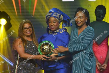 Stock Picture of Desiree Ellis from South Africa (L) receives the Womens coach of the Year award from FIFA secretary general Fatma Samoura (C) during the Confederation of African Football (CAF) awards at the Abdou Diouf International Conference Center in Dakar, Senegal, 08 January 2019. Chrestinah Thembi Kgatlana also won the best goal award.