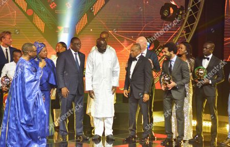 Mohamed Salah (2-R) from Egypt receives the Player of the Year award with runner up Sadio Mane from Senegal (R), CAF president Ahmad Ahmad (3-R), Liberian president George Weah (4-R), Senegal president Macky Sall (3-L), FIFA secretary general Fatma Samoura (2-L), and Senegalese singer Youssou Ndour (L) during the Confederation of African Football (CAF) awards at the Abdou Diouf International Conference Center in Dakar, Senegal, 08 January 2019. Chrestinah Thembi Kgatlana also won the best goal award.