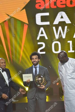 Stock Photo of Mohamed Salah from Egypt (C) receives the Player of the Year award from Liberian president George Weah (R) and CAF president Ahmad Ahmad (L) during the Confederation of African Football (CAF) awards at the Abdou Diouf International Conference Center in Dakar, Senegal, 08 January 2019.