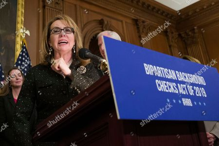 Former Rep. Gabby Giffords, speaks during a news conference to announce the introduction of bipartisan legislation to expand background checks for sales and transfers of firearms, on Capitol Hill, in Washington