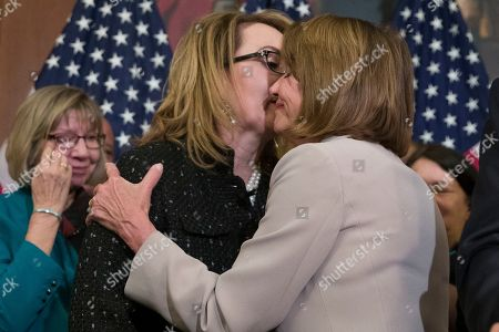 Nancy Pelosi, Gabby Giffords. House Speaker Nancy Pelosi of Calif., right, embraces gun violence victim former Rep. Gabby Giffords, during a news conference to announce the introduction of bipartisan legislation to expand background checks for sales and transfers of firearms, on Capitol Hill, in Washington