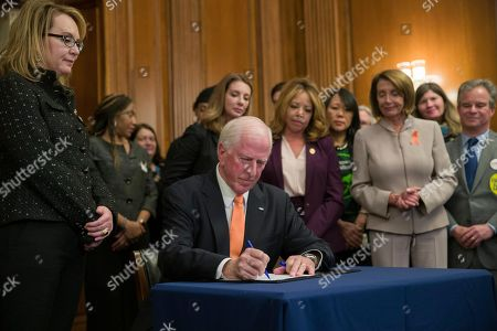 Nancy Pelosi, Mike Thompson, Gabby Giffords. House Speaker Nancy Pelosi of Calif., right, watches as Gun Violence Prevention Task Force Chairman fellow Democratic Rep. Mike Thompson, D-Calif., signs the bill, accompanied by gun violence victim former Rep. Gabby Giffords, right, and others, during a news conference to announce introduction of bipartisan legislation to expand background checks for sales and transfers of firearms, on Capitol Hill, in Washington