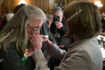 Nancy Pelosi, Sandy Phillips. Sandy Phillips, whose daughter Jessi Ghawi was killed in the Aurora, Colo., movie theater shooting, left, kisses the hands of House Speaker Nancy Pelosi of Calif., following a news conference to announce the introduction of bipartisan legislation to expand background checks for sales and transfers of firearms, on Capitol Hill, in Washington