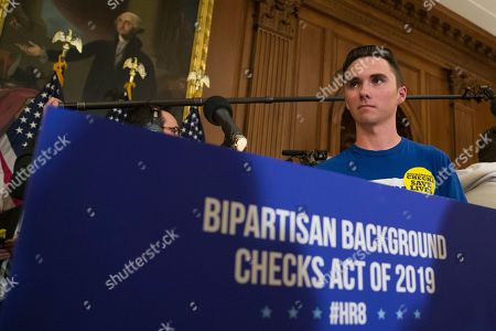 David Hogg, who survived the Stoneman Douglas High School shooting, stands in front of the podium after a news conference to announce introduction of bipartisan legislation to expand background checks for sales and transfers of firearms, on Capitol Hill, in Washington