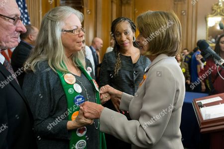 Sandy Phillips (L), whose 24-year-old daughter Jessi Ghawi was among those shot and killed in the Aurora, Colorado mass shooting of 2012, greets US Speaker of the House Nancy Pelosi (R) at an event to announce the introduction of legislation to expand background checks for sales and transfers of firearms, on Capitol Hill in Washington, DC, USA, 08 January 2019. The event was attended by lawmakers and those affected by gun violence. The eighth anniversary of Tucson, Arizona shooting that killed six people and wounded former US Representative Gabbie Giffords, occurs on 08 January 2019.