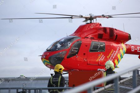 Prince William arrives at the Royal London Hospital on board the London air ambulance