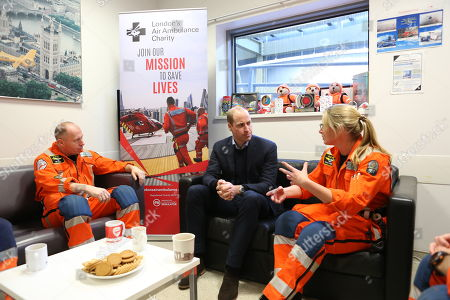 Stock Picture of Prince William talks with Air Ambulance crew
