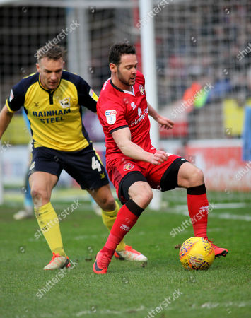 Matt Jarvis of Walsall and  Tony McMahon of  Scunthorpe during the Sky Bet League 1 match at the Banks's Stadium, Walsall 29/12/2018