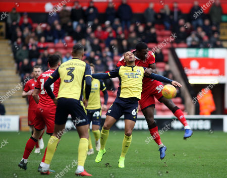 Isaiah Osbourne of Walsall and  Funso Ojo  of  Scunthorpe during the Sky Bet League 1 match at the Banks's Stadium, Walsall 29/12/2018