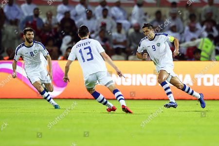 Stock Image of Odil Ahmedov (R) of Uzbekistan celebrates after scoring the 1-0 lead during the 2019 AFC Asian Cup group F preliminary round match between Uzbekistan and Oman in Sharjah, United Arab Emirates, 09 January 2019.