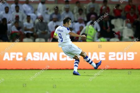 Odil Ahmedov of Uzbekistan scores the 1-0 lead during the 2019 AFC Asian Cup group F preliminary round match between Uzbekistan and Oman in Sharjah, United Arab Emirates, 09 January 2019.