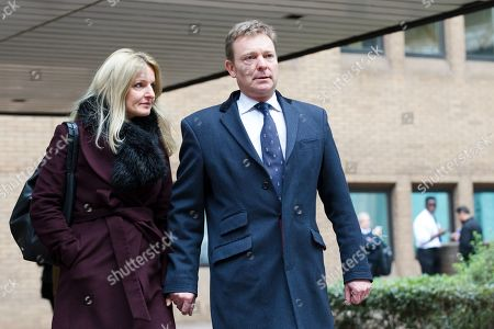 Stock Picture of Craig Mackinlay with his wife, Kati leave Southwark Crown Court after he was cleared of breaking electoral expenses rules in his 2015 general election campaign.