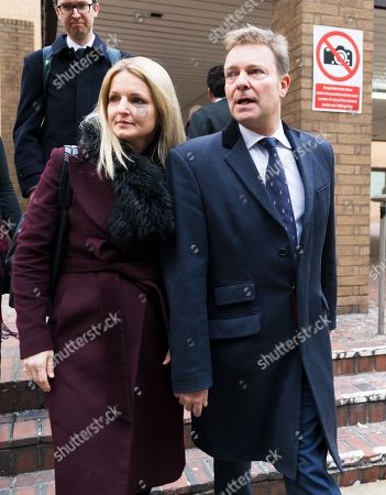 Stock Photo of Craig Mackinlay with his wife, Kati leave Southwark Crown Court after he was cleared of breaking electoral expenses rules in his 2015 general election campaign.