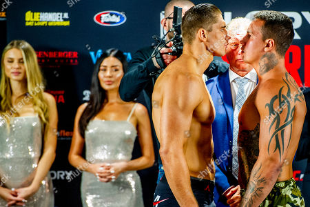 Rico Verhoeven and the Brazilian Guto Inocente during the stare down for Glory 59 Amsterdam.