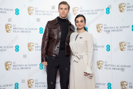 Will Poulter, Hayley Squires. Actors Will Poulter, left, and Hayley Squires pose for photographers following the BAFTA Film Awards nominations announcement in London