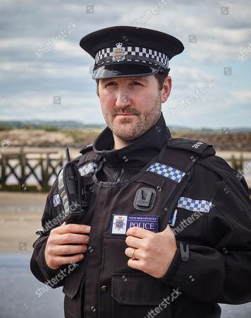 John Hollingworth as PC Shawn Turnly.
