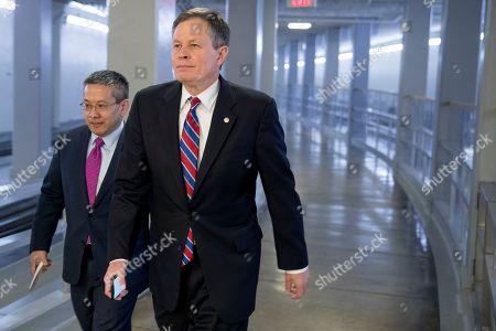 Stock Photo of Sen. Steve Daines, R-Mont., walks through the Senate subway on Capitol Hill in Washington