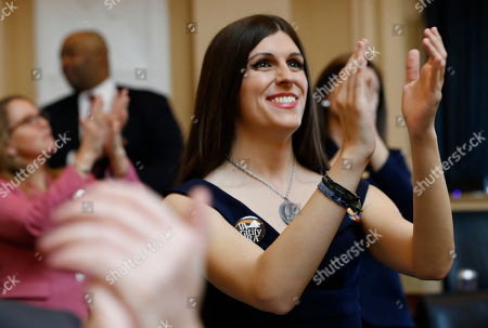 Del. Danica Roem, D-Prince William, right, applauds visitors during opening ceremonies at the start of the 2019 session of the Virginia General Assembly in the House chambers at the Capitol in Richmond, Va