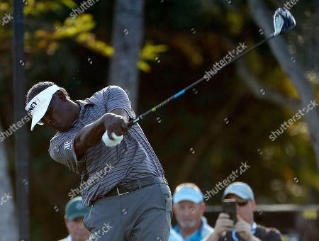 Vijay Singh hits from the first tee during the pro-am round of the Sony Open golf event, at the Waialae Country Club in Honolulu, Hawaii