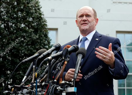 United States Senator Christopher A. Coons (Democrat of Delaware) addresses reporters outside the West Wing following a signing ceremony for Anti-Human Trafficking Legislation in the Oval Office of the White House