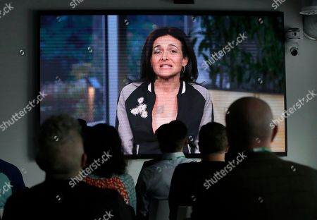 Facebook's chief operating officer Sheryl Sandberg speaks via video to media and guests before a tour of Facebook's new 130,000-square-foot offices, which occupy the top three floors of a 10-story Cambridge, Mass. building. The space gives the company room to triple its current local staff of more than 200. The Silicon Valley company, created by Mark Zuckerberg when he was two subway stops away at Harvard University, opened its first Boston office five years ago