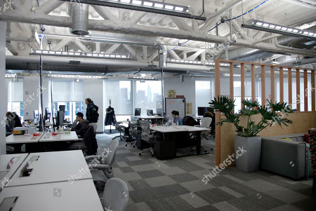 Facebook employees are seen at their stations during a tour of its new 130,000-square-foot offices, which occupy the top three floors of a 10-story Cambridge, Mass. building. The space gives the company room to triple its current local staff of more than 200. The Silicon Valley company, created by Mark Zuckerberg when he was two subway stops away at Harvard University, opened its first Boston office five years ago