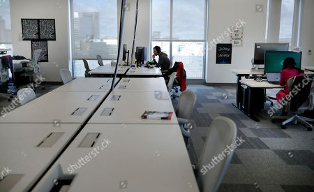 Stock Picture of Facebook employees are seen at their stations during a tour of its new 130,000-square-foot offices, which occupy the top three floors of a 10-story Cambridge, Mass. building. The space gives the company room to triple its current local staff of more than 200. The Silicon Valley company, created by Mark Zuckerberg when he was two subway stops away at Harvard University, opened its first Boston office five years ago