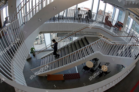 A man walks down a stairway at Facebook's new 130,000-square-foot offices, which occupy the top three floors of a 10-story Cambridge, Mass. The space gives the company room to triple its current local staff of more than 200. The Silicon Valley company, created by Mark Zuckerberg when he was two subway stops away at Harvard University, opened its first Boston office five years ago