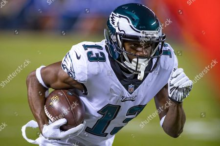Stock Photo of Chicago, Illinois, U.S. - Eagles #13.Nelson Agholor runs with the ball during the NFL Playoff Game between the Philadelphia Eagles and Chicago Bears at Soldier Field in Chicago, IL. Photographer: Mike Wulf
