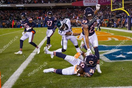 Chicago, Illinois, U.S. - Bears #38 Adrian Amos catches an interception in the end zone intended for Eagles #13 Nelson Agholor during the NFL Playoff Game between the Philadelphia Eagles and Chicago Bears at Soldier Field in Chicago, IL. Photographer: Mike Wulf