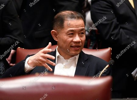 Sen. John Liu, D-Queens, talks to Senate members on opening day of the 2019 legislative session in the Senate Chamber at the Capitol, in Albany, N.Y