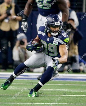 Seattle Seahawks wide receiver Doug Baldwin (89) looks for running room against the Dallas Cowboys during an NFC wild-card NFL football game in Arlington, Texas