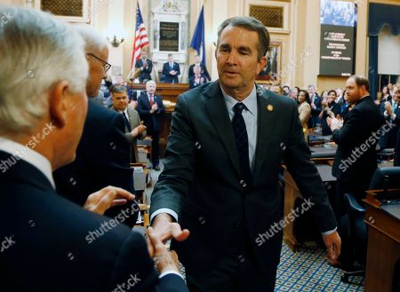 Ralph Northam, John Edwards. Virginia Gov. Ralph Northam shakes hands with state Sen. John Edwards, D-Roanoke, left, as he leaves the chambers after delivering his State of the Commonwealth address during a joint session of the Virginia Legislature in the House chambers at the Capitol in Richmond, Va
