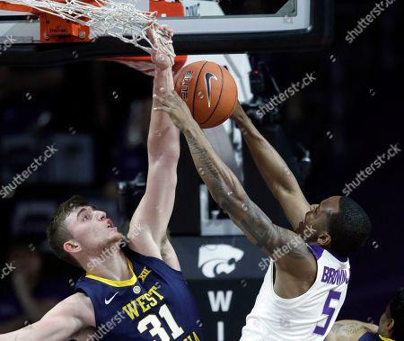 Logan Routt, Barry Brown Jr. West Virginia forward Logan Routt (31) blocks a shot by Kansas State guard Barry Brown Jr. (5) during the first half of an NCAA college basketball game in Manhattan, Kan