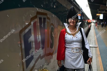 Elvis impersonator Jenny Dollin poses for a photograph before boarding the Elvis Express at Central Station in Sydney, Australia, 10 January 2019. The Elvis Express train leaves from Central Station for its journey to Parkes for the Elvis festival. The Elvis Express and the Blue Suede Express trains will make their way to Parkes for the annual pilgrimage to the Elvis Festival., heading to the New South Wales country town, 365km west of Sydney, for the annual January pilgrimage.