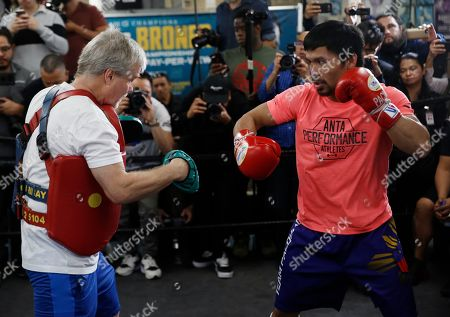 Freddie Roach, Manny Pacquiao. Manny Pacquiao, right, works out with trainer Freddie Roach at a boxing club in Los Angeles, . Pacquiao is scheduled to defend his WBA welterweight title against Adrien Broner on Jan. 19 in Las Vegas