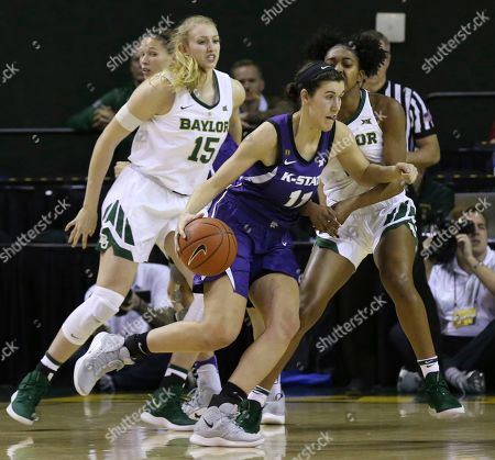 Kansas State forward Peyton Williams, center, drives around Baylor forward Lauren Cox, left, and Baylor guard DiDi Richards, right, in the first half of an NCAA college basketball game, in Waco, Texas