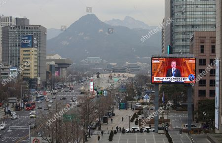 """A TV screen shows the live broadcast of South Korean President Moon Jae-in's press conference in Seoul, South Korea, . Moon has suggested he'll push for sanction exemptions to restart dormant economic cooperation projects with North Korea. The slug reads: """"Basic pension expansion"""