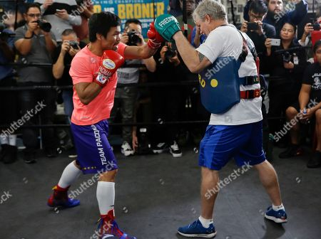 Freddie Roach, Manny Pacquiao. Manny Pacquiao, left, works out with trainer Freddie Roach at a boxing club in Los Angeles, . Pacquiao is scheduled to defend his WBA welterweight title against Adrien Broner on Jan. 19, 2019, in Las Vegas