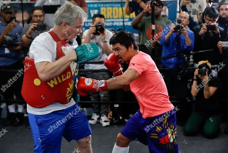 Freddie Roach, Manny Pacquiao. Manny Pacquiao, right, works out with trainer Freddie Roach at a boxing club in Los Angeles, . Pacquiao is scheduled to defend his WBA welterweight title against Adrien Broner on Jan. 19, 2019, in Las Vegas