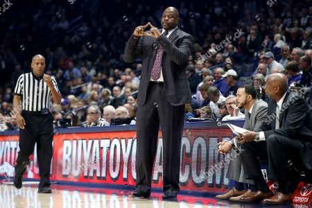 Georgetown head coach Patrick Ewing directs his players during the second half of an NCAA college basketball game against Xavier, in Cincinnati