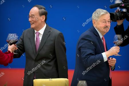 Wang Qishan, Terry Branstad. Chinese Vice President Wang Qishan, left, and U.S. Ambassador to China Terry Branstad toast during an event commemorating the 40th anniversary of the establishment of diplomatic relations between the United States and China at the Great Hall of the People in Beijing