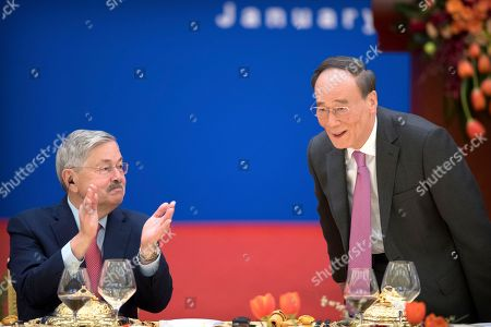 US Ambassador to China Terry Branstad (L) applauds as Chinese Vice President Wang Qishan (R) is introduced at an event commemorating the 40th anniversary of the establishment of diplomatic relations between the United States and China at the Great Hall of the People in Beijing, China, 10 January 2019.
