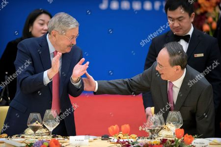 US Ambassador to China Terry Branstad (L) and Chinese Vice President Wang Qishan (R) talk during an event commemorating the 40th anniversary of the establishment of diplomatic relations between the United States and China at the Great Hall of the People in Beijing, China, 10 January 2019.